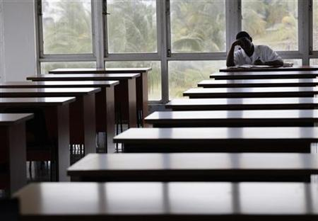 A medical student of Cuba's ELAM (Latin American School of Medicine) studies in the campus library on the outskirts of Havana March 11, 2010. REUTERS/Desmond Boylan