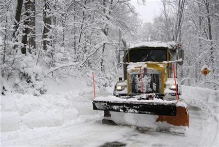 A VDOT (Virginia Department of Transportation) snow plow clears snow after a heavy snowstorm in Great Falls, Virginia February 6, 2010. REUTERS/Hyungwon Kang