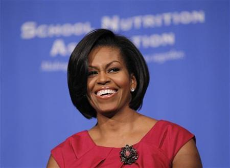 U.S. first lady Michelle Obama smiles as she speaks to hundreds of school nutrition professionals to advocate for adequate funds for healthy school meals, at the School Nutrition Association annual legislative action conference in Washington, March 1, 2010. REUTERS/Jason Reed