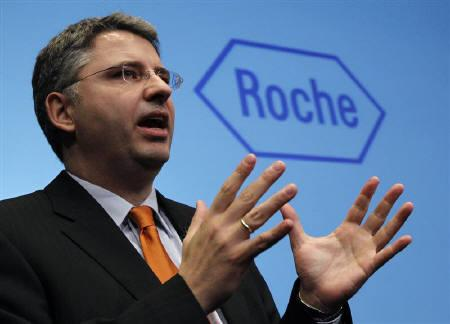 A file photo of Swiss pharmaceutical company Roche CEO Severin Schwan addresses media as he attends the company's annual news conference in Basel February 3, 2010.    REUTERS/Christian Hartmann/Files