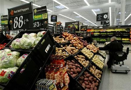 A shopper looks through produce as the first Wal Mart Supercenter to operate in the State of California opened in La Quinta, California, March 3, 2004. REUTERS/Robert Galbraith