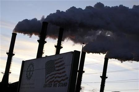 Smoke rises from chimneys at the Sugar Cane Growers cooperative in Belle Glade, Florida January 6, 2010. REUTERS/Carlos Barria
