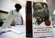 "<p>A woman looks at pictures and books of U.S. human rights activist Martin Luther King Jr at the commemorative exhibition ""Justice Everywhere"" in Colombo February 6, 2010. REUTERS/Dinuka Liyanawatte</p>"