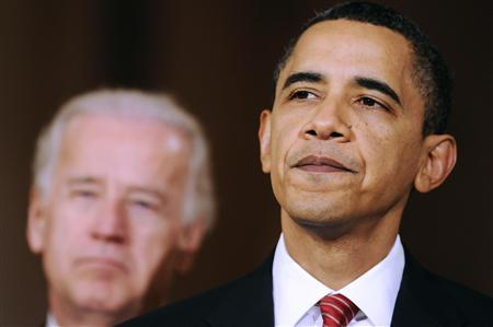U.S. President Barack Obama is flanked by Vice President Joe Biden (L) as he makes a statement about the House of Representatives' final passage of health care legislation, in the East Room of the White House in Washington, March 21, 2010. Obama on Sunday hailed the House of Representatives vote for his sweeping healthcare plan as a victory for the American people that answered the call of history. REUTERS/Jonathan Ernst