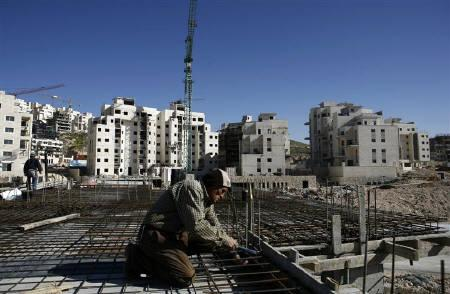 A Palestinian labourer works on a construction site at a Jewish settlement near Jerusalem known to Israelis as Har Homa and to Palestinians as Jabal Abu Ghneim March 22, 2010. REUTERS/Baz Ratner