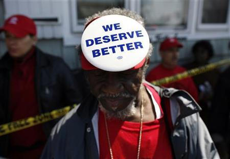 Demonstrators from ACORN's Home Defenders rally outside the foreclosed home of Marie Elie in Elmont, New York, April 9, 2009. REUTERS/Shannon Stapleton