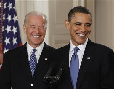 President Obama and Vice President Joe Biden smile during a ceremony where Obama signed comprehensive healthcare reform legislation into law in the East Room of the White House, March 23, 2010. REUTERS/Jason Reed