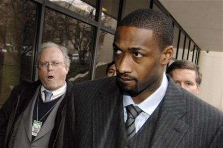Washington Wizards guard Gilbert Arenas, currently serving an indefinite suspension from the NBA, is trailed by reporters as he arrives to face felony gun charges at the District of Columbia Superior Courthouse in Washington, January 15, 2010. REUTERS/Jonathan Ernst