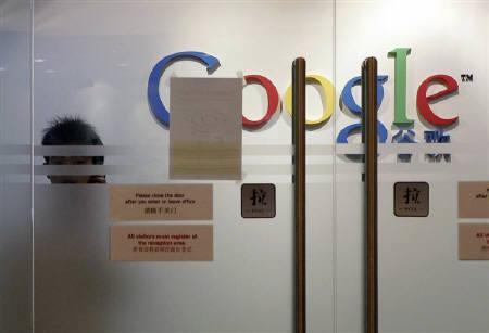China newspaper accuses google of helping us intelligence reuters a man looks from behind a glass door at the google inc shanghai office in shanghai planetlyrics Gallery