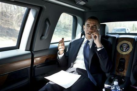 President Barack Obama talks on the phone en route to George Mason University in Fairfax, Virginia, in this handout picture taken on March 19, 2010 REUTERS/Pete Souza/The White House/Handout