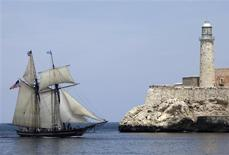 "<p>The Schooner ""Amistad"" (Friendship) flies the U.S. flag and Cuban flag as it approaches Havana Harbor, March 25, 2010. REUTERS/Enrique De La Osa</p>"
