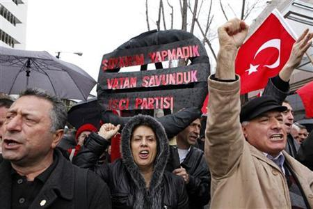 Protesters shout slogans as they demonstrate in front of the U.S. Embassy in Ankara March 5, 2010. REUTERS/Umit Bektas