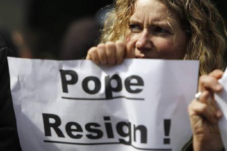 A demonstrator calls for Pope Benedict to resign during a protest outside of Westminster Cathedral in London March 28, 2010. REUTERS/Suzanne Plunkett