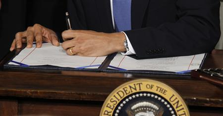 President Barack Obama signs the health insurance reform bill during a ceremony in the East Room of the White House in Washington, March 23, 2010. REUTERS/Jason Reed