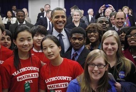 U.S. President Barack Obama poses with students from various schools following his remarks on science, technology, engineering and math education initiatives in the Eisenhower Executive Office building in Washington, November 23, 2009. REUTERS/Jason Reed