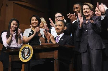 President Barack Obama applauds onstage with students and House Speaker Nancy Pelosi (2nd R) after signing the Health Care and Education Reconciliation Act into law at Northern Virginia Community College in Alexandria, Virginia, March 30, 2010. REUTERS/Jonathan Ernst