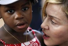 <p>U.S. pop star Madonna holds her adopted Malawian child Mercy James during a visit to Gumulira village, about 80 km (50 miles) from the Malawian capital Lilongwe, April 5, 2010.REUTERS/Mike Hutchings</p>