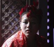 <p>6 aprile 2010. Chanira Bajracharya, Kumari del Patan, in foto d'archivio. REUTERS/Gopal Chitrakar</p>