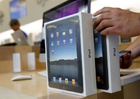 Apple iPads are prepared for purchase during an iPad launch event at the Apple retail store in San Francisco, California April 3, 2010. REUTERS/Robert Galbraith/Files