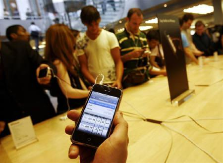 The iPhone is held inside the Apple Store in New York June 29, 2007. REUTERS/Shannon Stapleton/Files
