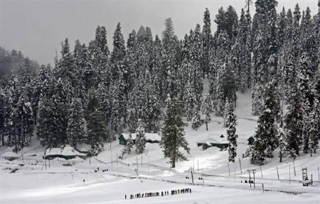 Trainee skiers line up during a practice session in Gulmarg, 55km (34 miles) west of Srinagar in this January 30, 2008 file photo. REUTERS/Fayaz Kabli/Files