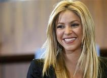 <p>Pop singer Shakira smiles during a ceremony before receiving the ILO (International Labour Office) medal for her support for Social Justice for Peace through her foundation in Geneva March 3, 2010. REUTERS/Denis Balibouse</p>