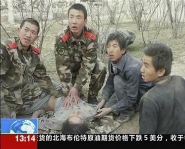 A video grab shows soldiers and residents rescuing a survivor after an earthquake, in Yushu County, Qinghai Province, April 14, 2010. REUTERS/CCTV