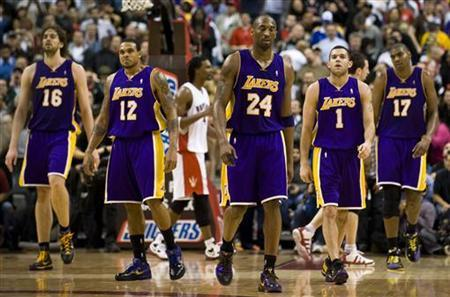 (From L to R) Los Angeles Lakers' Pau Gasol, Shannon Brown, Kobe Bryant, Jordan Farmar and Andrew Bynum walk back to the bench during a time-out against the Toronto Raptors during the second half of their NBA game in Toronto January 24, 2010. REUTERS /Adrien Veczan