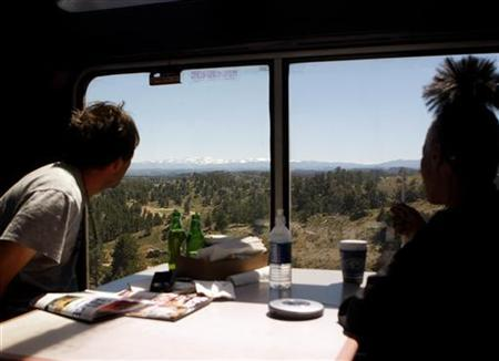 Passengers ride the 5 California Zephyr Amtrak train in Nevada June 14, 2008. REUTERS/Joshua Lott