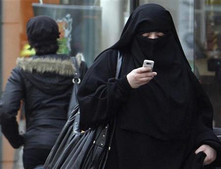 A woman wears a burqa as she walks on a street in Saint-Denis, near Paris, April 2, 2010. REUTERS/Regis Duvignau