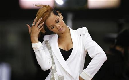 Singer Rihanna adjusts her hair while performing at an outdoor concert in Times Square during an appearance on ABC's Good Morning America, November 24, 2009. REUTERS/Finbarr O'Reilly