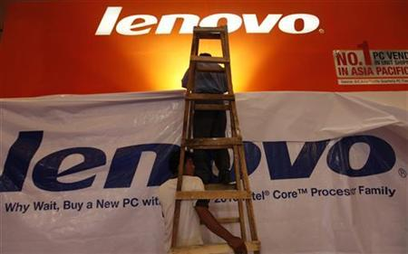 Worker setup the Lenovo booth at a computer and technology exhibition in Jakarta March 3, 2010. REUTERS/Beawiharta
