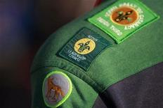 <p>A scout wears various merit badges as he participates in a ceremony in Sydney marking the World centenary of Scouting August 1, 2007. REUTERS/Tim Wimborne</p>