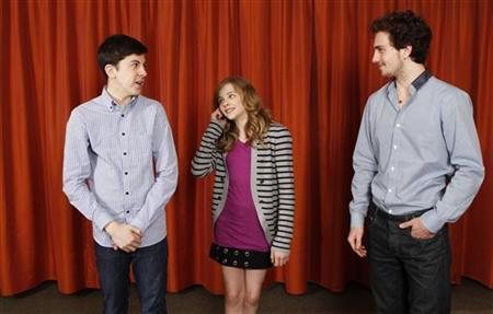 Actors (L-R) Christopher Mintz-Plasse, Chloe Moretz, and Aaron Johnson pose for a portrait during a media day promoting the film ''Kick-Ass'' in New York April 8, 2010. REUTERS/Lucas Jackson