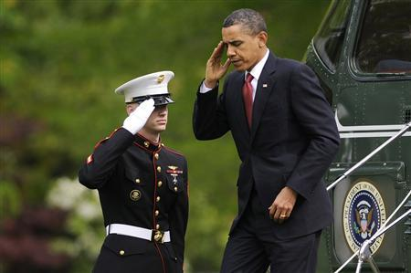 President Barack Obama (R) is saluted as he returns to the White House a visit in California, in Washington, April 20, 2010. REUTERS/Jonathan Ernst