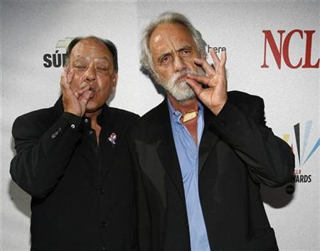 Actors Cheech Marin (L) and Tommy Chong gesture as they arrive for the taping of the 2008 ''NCLR Alma'' awards at the Civic Auditorium in Pasadena, California, August 17, 2008. REUTERS/Mario Anzuoni