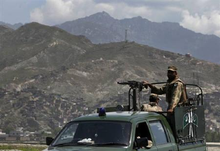 Pakistani soldiers keep guard on the side of a road in Mingora, Swat on April 23, 2010. REUTERS/Faisal Mahmood