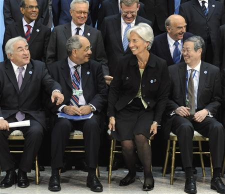 Finance Minister of France Christine Lagarde (3rd R) elicits laughter from IMF Managing Director Dominique Strauss-Kahn (L-R), India's central bank Governor Duvvuri Subbarao, Egypt's Minister of Finance Youssef Boutros Ghali, Italy's Minister of Finance Giulio Tremonti, Russia's Finance Minister Alexei Kudrin, Switzerland's Finance Minister Hans-Rudolf Merz and Governor of the People's Bank of China Zhou Xiaochuan as she arrives next-to-last for an International Monetary and Financial Committee (IMFC) group photo at the International Monetary Fund/World Bank Spring Meetings at IMF headquarters in Washington, April 24, 2010. REUTERS/Jonathan Ernst