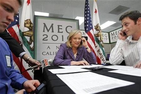 California Republican Gubernatorial candidate and former eBay chief executive Meg Whitman (C), flanked by volunteers, speaks to a potential voter at the opening of her campaign's Orange County headquarters in Costa Mesa, California February 22, 2010. REUTERS/Mario Anzuoni