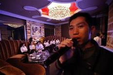 <p>A man sings at the newly-opened Obama entertainment club in Shanghai April 25, 2010. REUTERS/Aly Song</p>