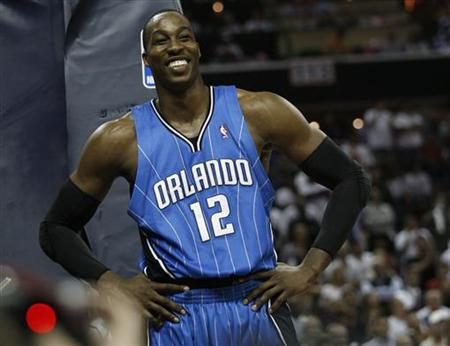 Orlando Magic center Dwight Howard (12) smiles in the second half against the Charlotte Bobcats during Game 4 of their NBA Eastern Conference playoff series in Charlotte, North Carolina April 26, 2010. REUTERS/Jason Miczek