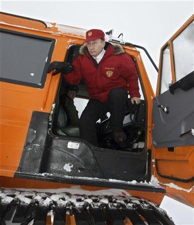 Russian Prime Minister Vladimir Putin gets out of an off-road vehicle during his visit to Alexandra Land on Franz Josef Land in the far north of Russia in the Barents Sea April 29, 2010. REUTERS/RIA Novosti/Pool/Alexei Nikolsky
