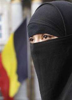 Salma, a 22-year-old French national living in Belgium who chooses to wear the niqab after converting to Islam, gives an interview to Reuters television outside the Belgian Parliament in Brussels April 26, 2010. REUTERS/Yves Herman