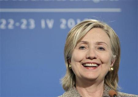 Secretary of State Hillary Clinton smiles as she speaks at a news conference during the informal NATO Foreign Ministers meeting in Tallinn April 23, 2010. REUTERS/Ints Kalnins