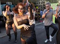 <p>Revelles perform Michael Jackson's Thriller during the 32th annual gay and lesbian Mardi Gras parade in central Sydney February 27, 2010. REUTERS/Daniel Munoz</p>