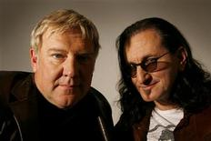 <p>Members of the legendary Canadian rock band RUSH, Alex Lifeson (L) and Geddy Lee, pose for photographs during an interview with Reuters in New York April 23, 2010. REUTERS/Mike Segar</p>