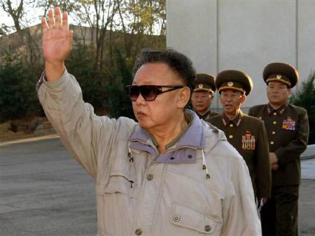 Supreme Commander of North Korean People's Army (front) Kim Jong-il waves as he visits the 2200 military unit to see military training at an undisclosed place in North Korea, in this undated picture released by KCNA November 5, 2008. REUTERS/KCNA/Files