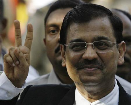 Special Prosecutor Ujjwal Nikam flashes a victory sign to the media outside the Arthur Road Jail, where the trial of Mohammad Ajmal Kasab, the lone surviving gunman of the Mumbai attacks, was held, in Mumbai May 3, 2010. REUTERS/Arko Datta