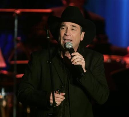 Country music singer Clint Black performs at the Thalians 50th anniversary gala in Los Angeles October 8, 2005 file photo. REUTERS/Fred Prouser