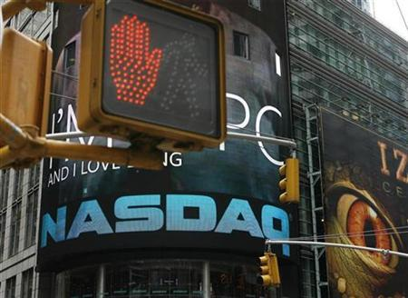 A NASDAQ screen above Times Square in a file photo. REUTERS/Lucas Jackson